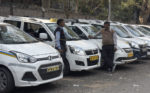 Black ribbons and placards at Barakhamba: taxi drivers protest rising fuel prices